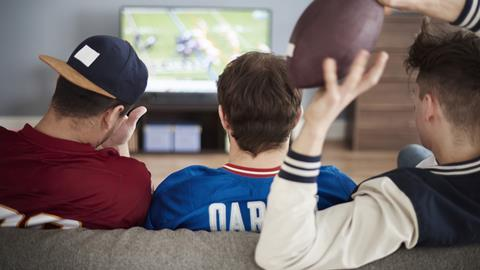 Boys watching super bowl 16x9