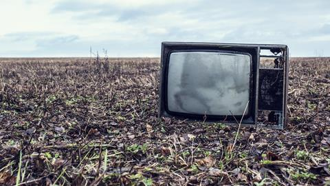 Tv set abandoned in field 16x9