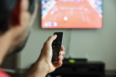 Man tv viewing remote