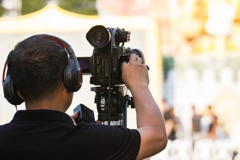 Behind the scenes tv cameraman outside broadcast