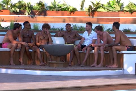 The boys around the fire pit: Love Island series 4